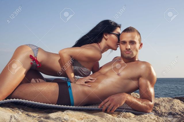 26444319-Couple-lies-on-beach-Girl-kissing-guy-Sto Picture Box