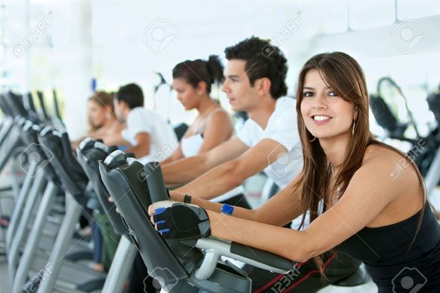 5593317-Group-of-gym-people-exercising-on-cardio-m Picture Box