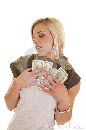 loving-money-woman-holding-to-her-chest-32691032 Picture Box
