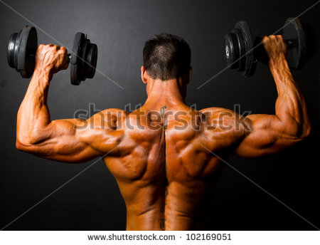 stock-photo-rear-view-of-bodybuilder-training-with http://www.beaudermaskincare.com/megamaximus-reviews/