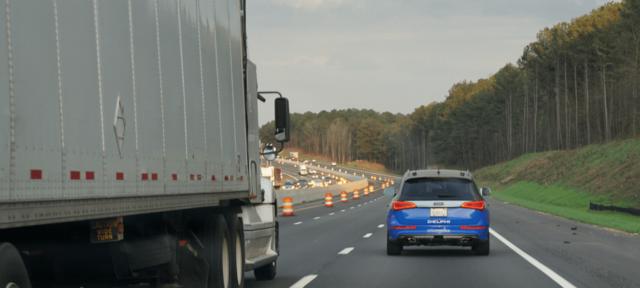 autonomous-driving-vehicle-next-to-semi-truck-comp Picture Box