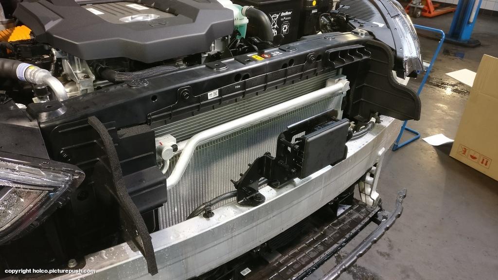 https://www1.picturepush.com/photo/a/15840099/1024/Hyundai-Ioniq-Electric/Hyundai-Ioniq-Electric-front-spoiler-removed-2.jpg