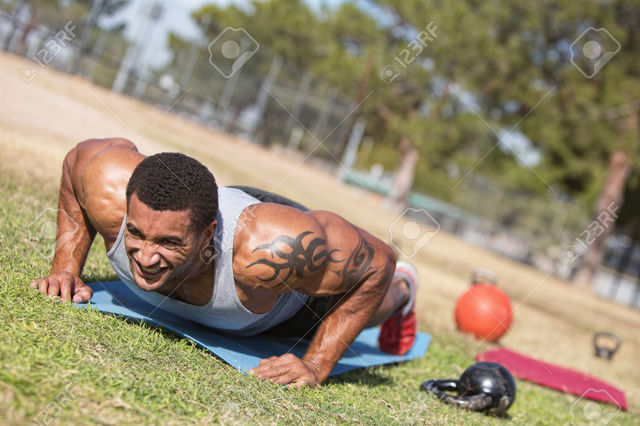 26181163-Strong-man-with-tattoo-doing-push-ups-out http://bettercoloncleansingguide.com/true-slim-garcinia/