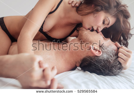 stock-photo-young-couple-being-intimate-kissing-on Picture Box