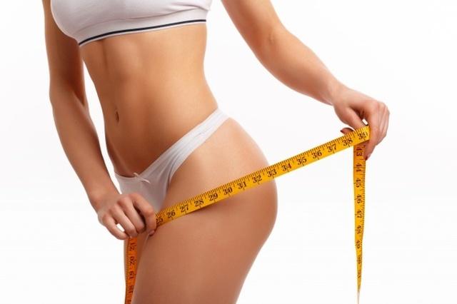 manos-de-mujer-midiendo-el-muslo 1208-94 Keto Kenetics Can Help You Lose Weight